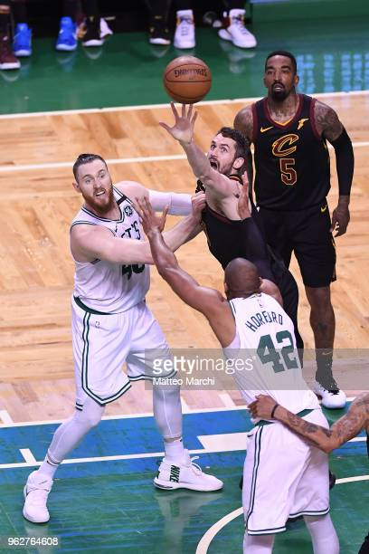 Kevin Love of the Cleveland Cavaliers fights for a rebound against Aron Baynes of the Boston Celtics during Game Five of the 2018 NBA Eastern...