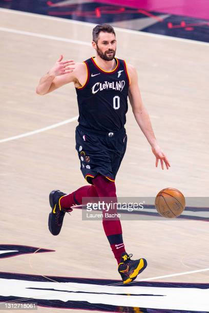 Kevin Love of the Cleveland Cavaliers gestures to his teammates as he dribbles the ball down the court in the first half against the Golden State...