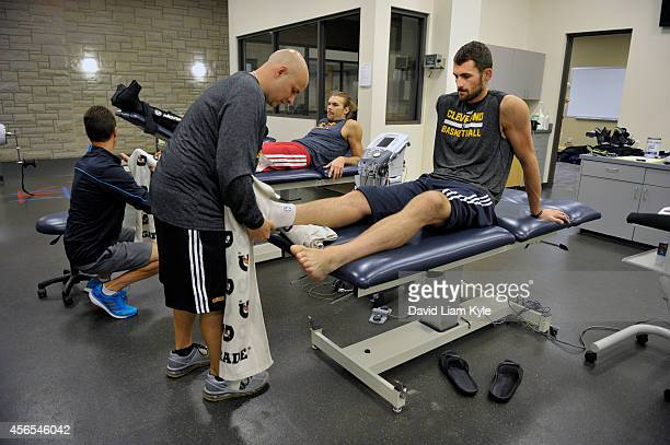 Kevin Love of the Cleveland Cavaliers gets his foot checked during a practice at The Cleveland Clinic Courts on September 30 2014 in Independence...