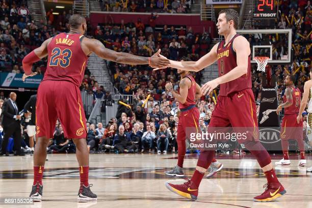 Kevin Love of the Cleveland Cavaliers gives high five to LeBron James of the Cleveland Cavaliers during the game against the Indiana Pacers on...