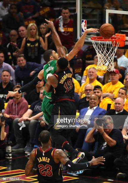 Kevin Love of the Cleveland Cavaliers goes up with the ball against Tristan Thompson of the Cleveland Cavaliers in the first quarter during Game Four...