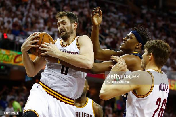 Kevin Love of the Cleveland Cavaliers grabs a first half rebound next to Myles Turner of the Indiana Pacers in Game One of the Eastern Conference...