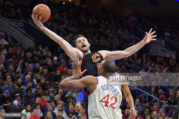 Kevin Love of the Cleveland Cavaliers grabs a rebound above Al Horford of the Philadelphia 76ers in the first half at Wells Fargo Center on December...