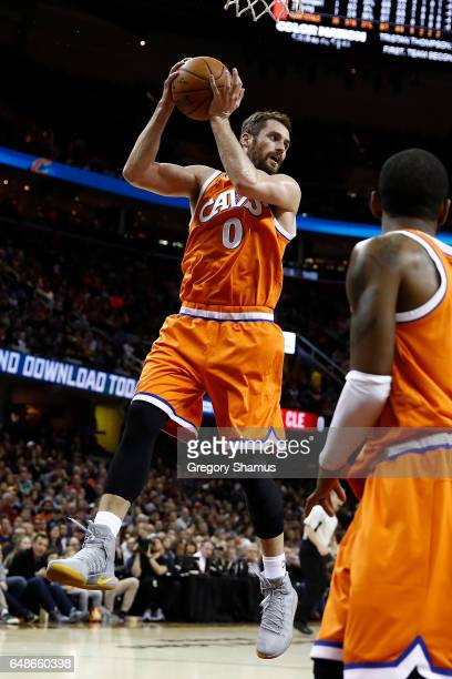 Kevin Love of the Cleveland Cavaliers grabs a rebound while playing the Oklahoma City Thunder at Quicken Loans Arena on January 29 2017 in Cleveland...