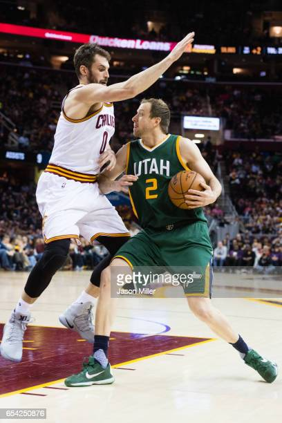Kevin Love of the Cleveland Cavaliers guards Joe Ingles of the Utah Jazz during the second half at Quicken Loans Arena on March 16, 2017 in...