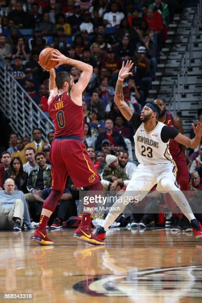 Kevin Love of the Cleveland Cavaliers handles the ball against Anthony Davis of the New Orleans Pelicans on October 28 2017 at the Smoothie King...