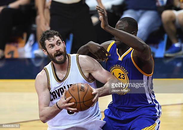 Kevin Love of the Cleveland Cavaliers handles the ball against Draymond Green of the Golden State Warriors during the first half in Game 4 of the...