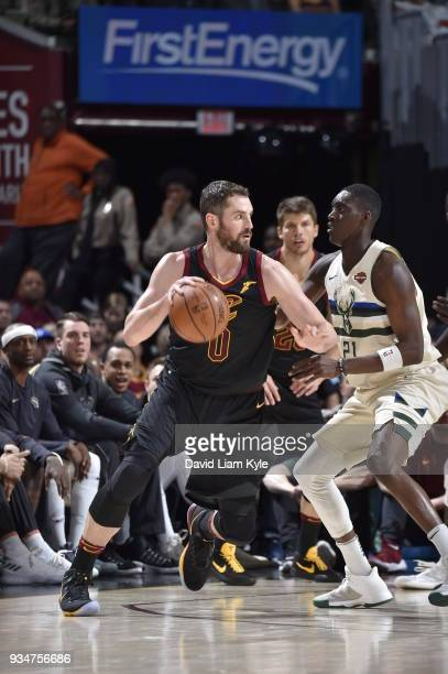 Kevin Love of the Cleveland Cavaliers handles the ball against the Milwaukee Bucks on March 19 2018 at Quicken Loans Arena in Cleveland Ohio NOTE TO...