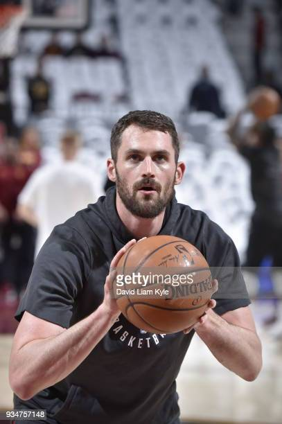 Kevin Love of the Cleveland Cavaliers handles the ball before the game against the Milwaukee Bucks on March 19 2018 at Quicken Loans Arena in...