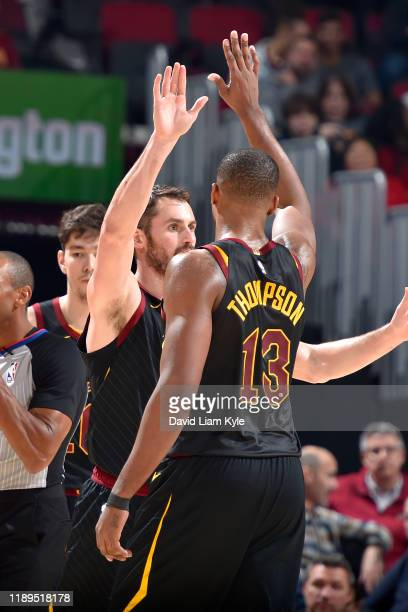 Kevin Love of the Cleveland Cavaliers highfives Tristan Thompson of the Cleveland Cavaliers against the Charlotte Hornets on December 18 2019 at...