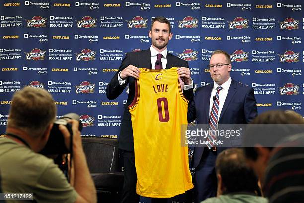 Kevin Love of the Cleveland Cavaliers holds up his new jersey as he is introduced to the media alongside General Manager David Griffin at The...