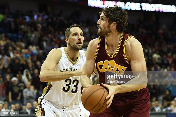 Kevin Love of the Cleveland Cavaliers is defended by Ryan Anderson of the New Orleans Pelicans during a game at the Smoothie King Center on December...