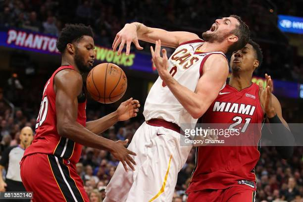 Kevin Love of the Cleveland Cavaliers is fouled while taking a shot between Hassan Whiteside and Justise Winslow of the Miami Heat during the second...