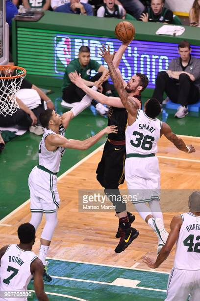 Kevin Love of the Cleveland Cavaliers lays up a shot against Marcus Smart of the Boston Celtics during Game Five of the 2018 NBA Eastern Conference...