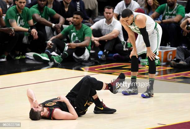 Kevin Love of the Cleveland Cavaliers lies on the court as Jayson Tatum of the Boston Celtics reacts after colliding in the first quarter during Game...