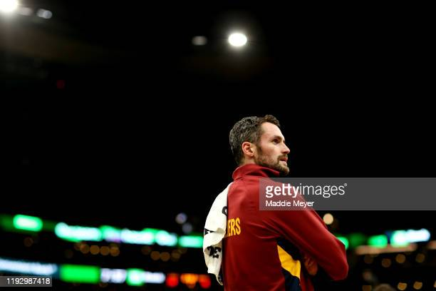 Kevin Love of the Cleveland Cavaliers looks on during a timeout during the first half of the game against the Boston Celtics at TD Garden on December...