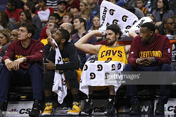 Kevin Love of the Cleveland Cavaliers looks on from the bench against the Washington Wizards during the second half at Verizon Center on February 28...