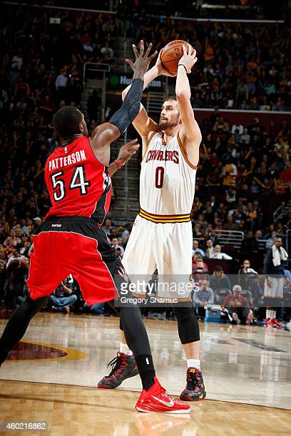 Kevin Love of the Cleveland Cavaliers looks to pass against Patrick Patterson of the Toronto Raptors on December 9 2014 at The Quicken Loans Arena in...