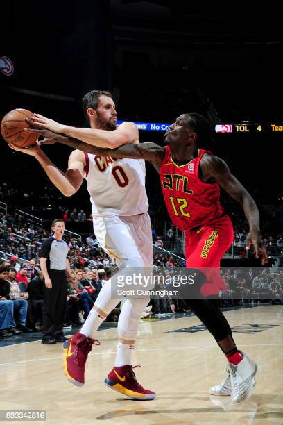 Kevin Love of the Cleveland Cavaliers looks to pass the ball against Taurean Prince of the Atlanta Hawks on November 30 2017 at Philips Arena in...