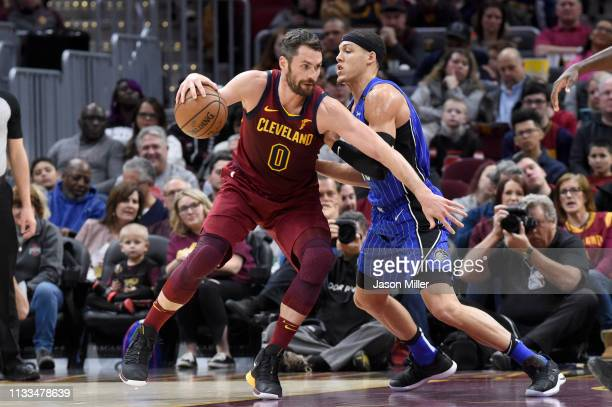 Kevin Love of the Cleveland Cavaliers posts up against Aaron Gordon of the Orlando Magic during the first half at Quicken Loans Arena on March 03...