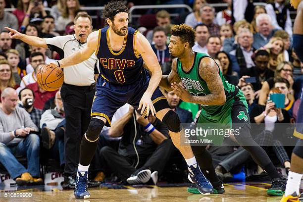 Kevin Love of the Cleveland Cavaliers posts up against Marcus Smart of the Boston Celtics during the second half at Quicken Loans Arena on February 5...