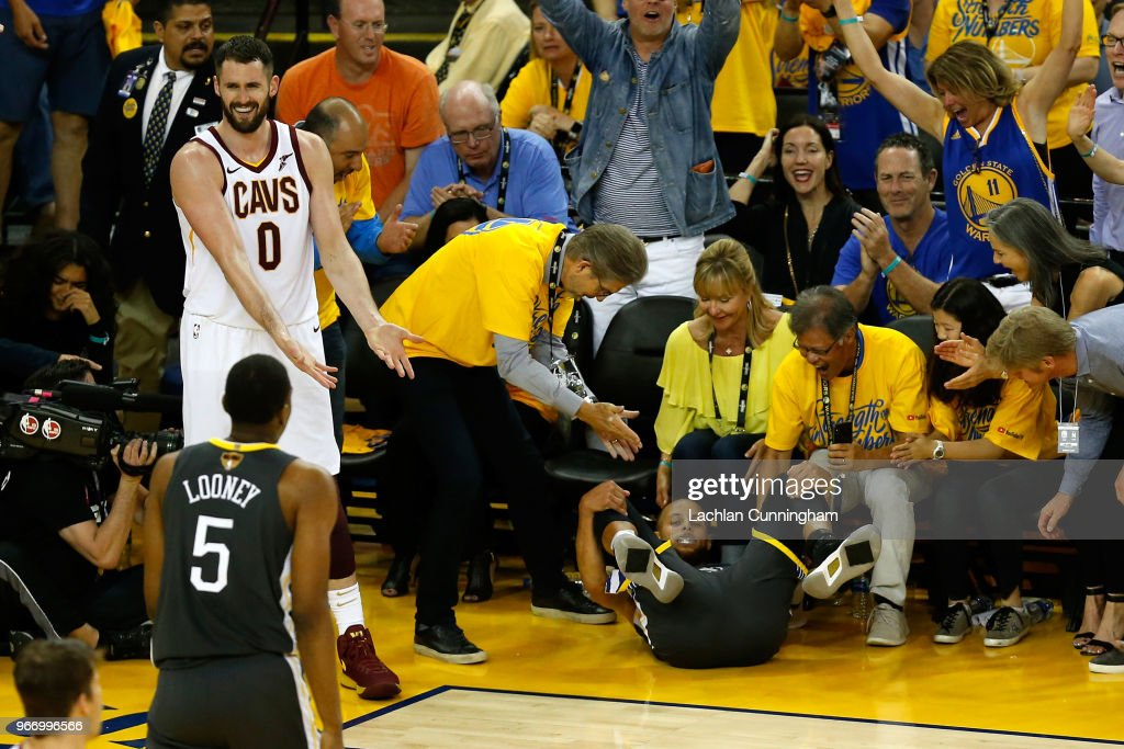 Kevin Love #0 of the Cleveland Cavaliers reacts against Stephen Curry #30 of the Golden State Warriors in Game 2 of the 2018 NBA Finals at ORACLE Arena on June 3, 2018 in Oakland, California.