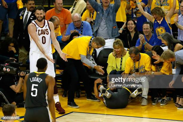 Kevin Love of the Cleveland Cavaliers reacts against Stephen Curry of the Golden State Warriors in Game 2 of the 2018 NBA Finals at ORACLE Arena on...