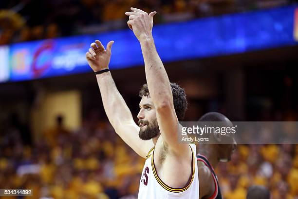 Kevin Love of the Cleveland Cavaliers reacts in the first quarter against the Toronto Raptors in game five of the Eastern Conference Finals during...
