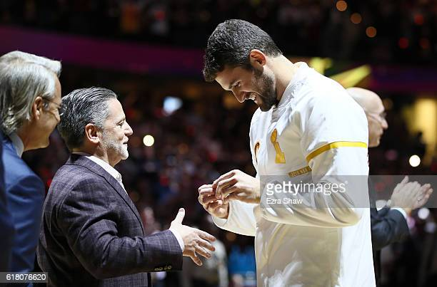 Kevin Love of the Cleveland Cavaliers receives his championship ring from owner Dan Gilbert before the game against the New York Knicks at Quicken...