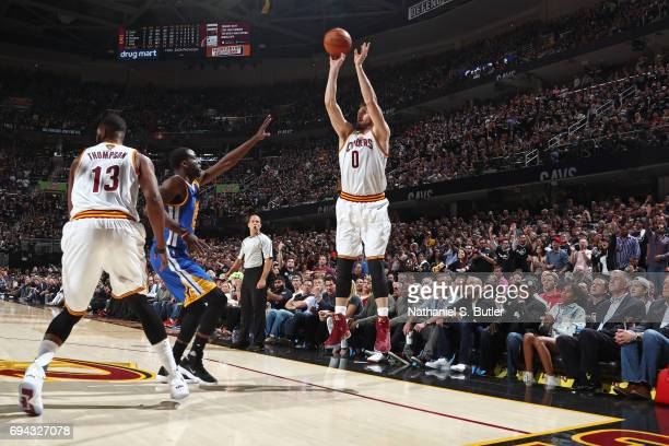 Kevin Love of the Cleveland Cavaliers shoots a three point basket against the Golden State Warriors in Game Four of the 2017 NBA Finals on June 9...