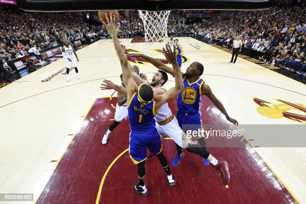 Kevin Love of the Cleveland Cavaliers shoots against JaVale McGee and Kevin Durant of the Golden State Warriors in the first half in Game 3 of the...