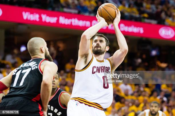 Kevin Love of the Cleveland Cavaliers shoots over Jonas Valanciunas of the Toronto Raptors during the second half of Game One of the NBA Eastern...