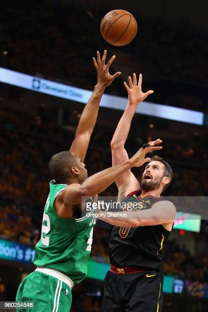 Kevin Love of the Cleveland Cavaliers shoots the ball against Al Horford of the Boston Celtics in the first half during Game Three of the 2018 NBA...