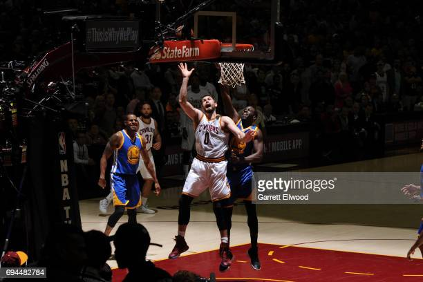 Kevin Love of the Cleveland Cavaliers shoots the ball against Draymond Green of the Golden State Warriors in Game Four of the 2017 NBA Finals on June...