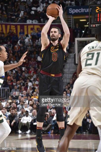 Kevin Love of the Cleveland Cavaliers shoots the ball against the Milwaukee Bucks on March 19 2018 at Quicken Loans Arena in Cleveland Ohio NOTE TO...