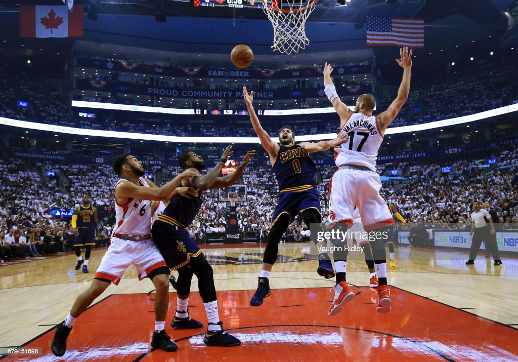 Kevin Love #0 of the Cleveland Cavaliers shoots the ball as Jonas Valanciunas #17 of the Toronto Raptors defends in the first half of Game Three of the Eastern Conference Semifinals during the 2017 NBA Playoffs at Air Canada Centre on May 5, 2017 in Toronto, Canada.