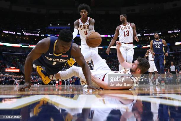 Kevin Love of the Cleveland Cavaliers takes a charge from Zion Williamson of the New Orleans Pelicans during the first half at the Smoothie King...
