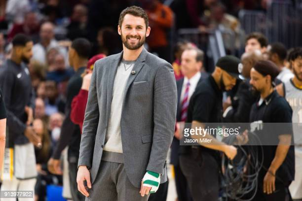 Kevin Love of the Cleveland Cavaliers talks to players on the Houston Rockets bench during a timeout during the second half at Quicken Loans Arena on...