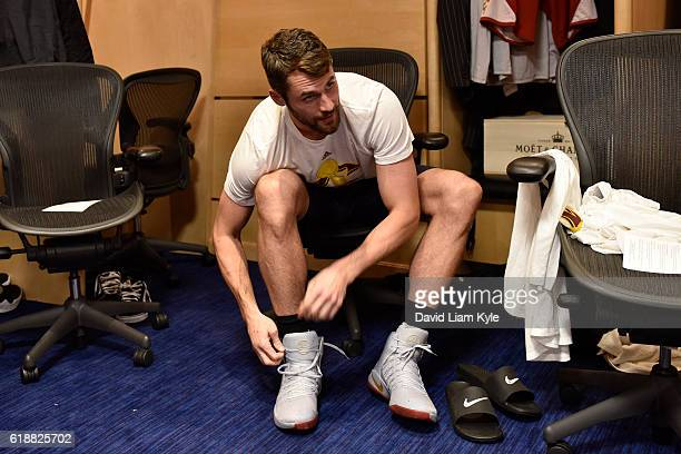 Kevin Love of the Cleveland Cavaliers ties his shoes before the game against the New York Knicks on October 25 2016 at Quicken Loans Arena in...