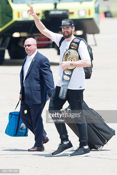Kevin Love of the Cleveland Cavaliers waves to the fans after returning to Cleveland after wining the NBA Championships on June 20 2016 in Cleveland...