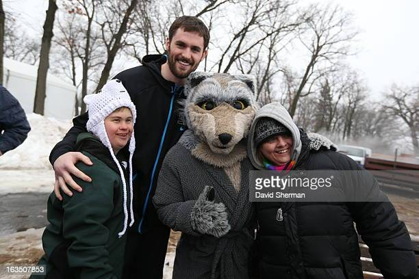 Kevin Love of the Minnesota Timberwolves and mascot Crunch of the Minnesota Timberwolves pose for a picture before jumping into Riley Lake during the...