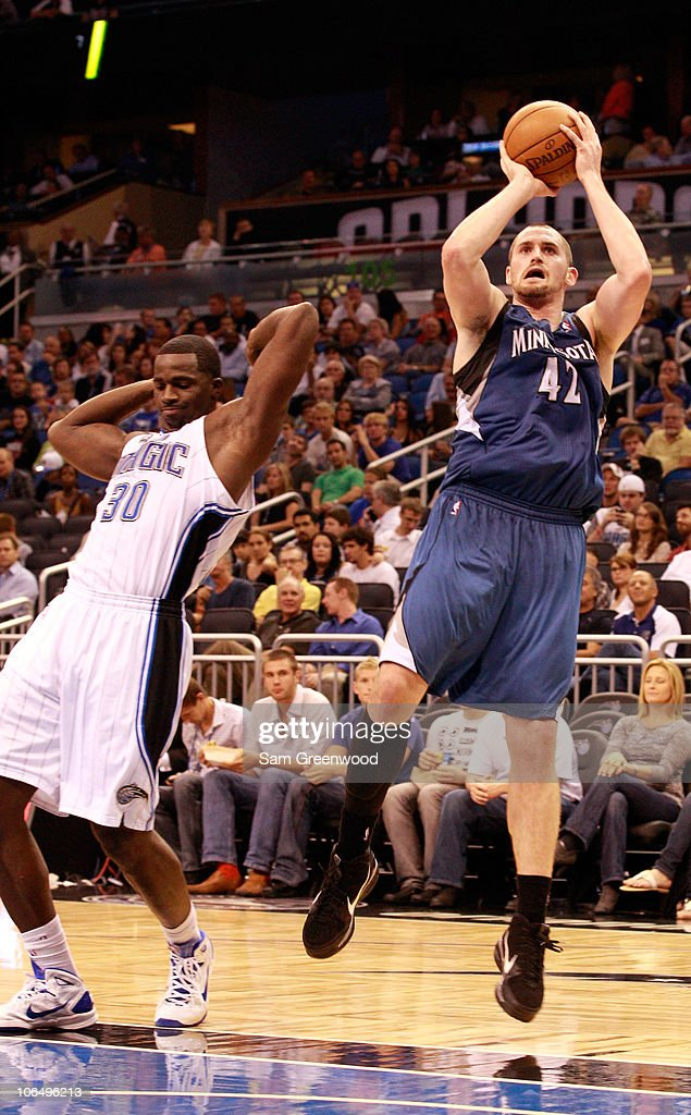 Kevin Love #42 of the Minnesota Timberwolves attempts a shot over Brandon Bass #30 of the Orlando Magic during the game at Amway Arena on November 3, 2010 in Orlando, Florida.