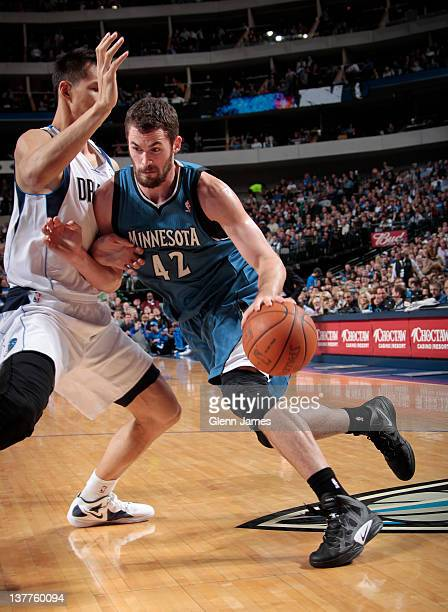 Kevin Love of the Minnesota Timberwolves drives against Yi Jianlian of the Dallas Mavericks on January 25 2012 at the American Airlines Center in...