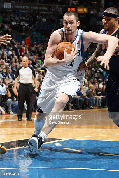 Kevin Love of the Minnesota Timberwolves drives to the basket against Kenyon Martin of the Denver Nuggets during the game on February 5 2011 at...
