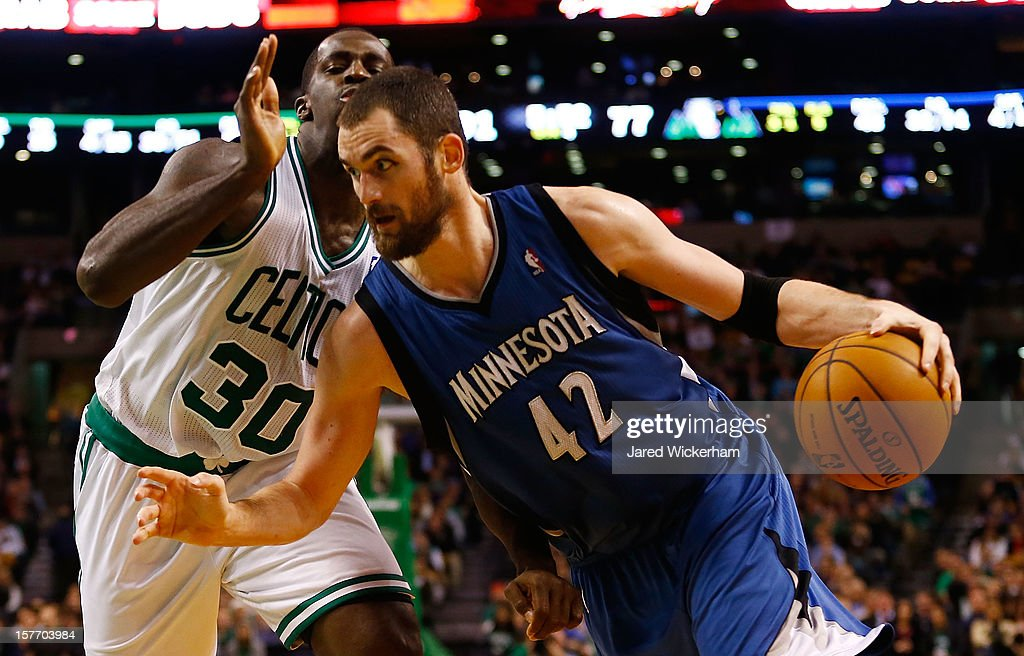 Kevin Love #42 of the Minnesota Timberwolves drives to the basket in front of Brandon Bass #30 of the Boston Celtics during the game on December 5, 2012 at TD Garden in Boston, Massachusetts.