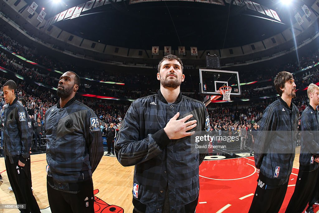 Kevin Love #42 of the Minnesota Timberwolves during the national anthem before the game against the Chicago Bulls on JANUARY 27, 2014 at the United Center in Chicago, Illinois.