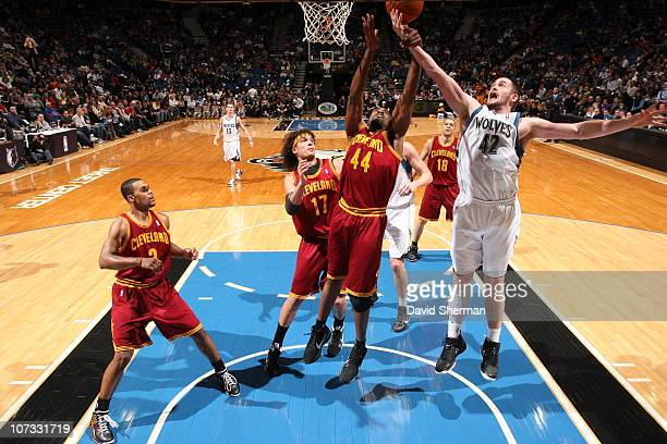 Kevin Love of the Minnesota Timberwolves fights for the rebound against Leon Powe of the Cleveland Cavaliers during the game on December 4 2010 at...