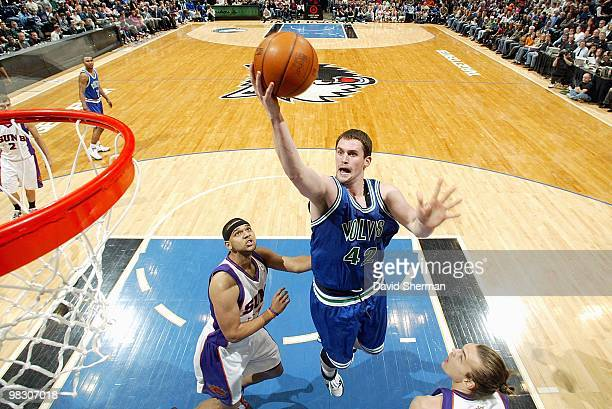 Kevin Love of the Minnesota Timberwolves goes to the basket against Jared Dudley of the Phoenix Suns during the game on March 28 2010 at the Target...