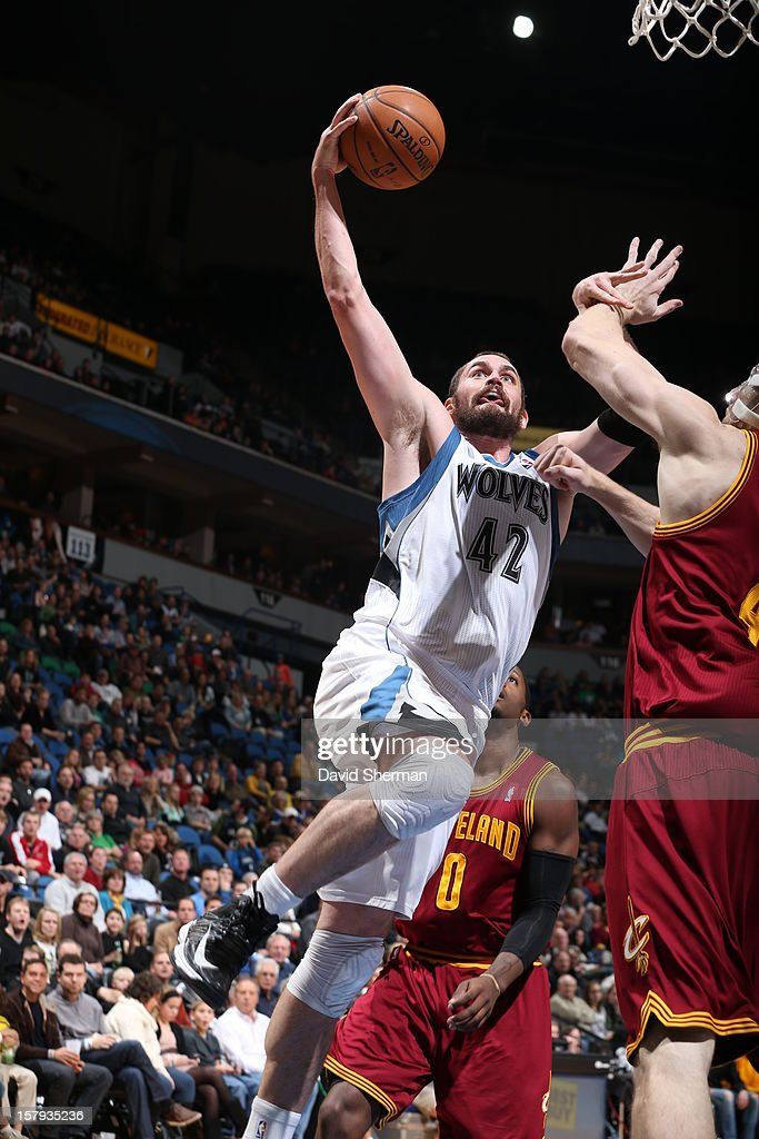 Kevin Love #42 of the Minnesota Timberwolves goes up strong to the basket against the Cleveland Cavaliers during the game on December 7, 2012 at Target Center in Minneapolis, Minnesota.