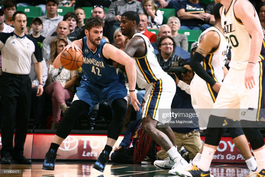 Kevin Love #42 of the Minnesota Timberwolves handles the ball against Marvin Williams #2 of the Utah Jazz at EnergySolutions Arena on February 22, 2014 in Salt Lake City, Utah.